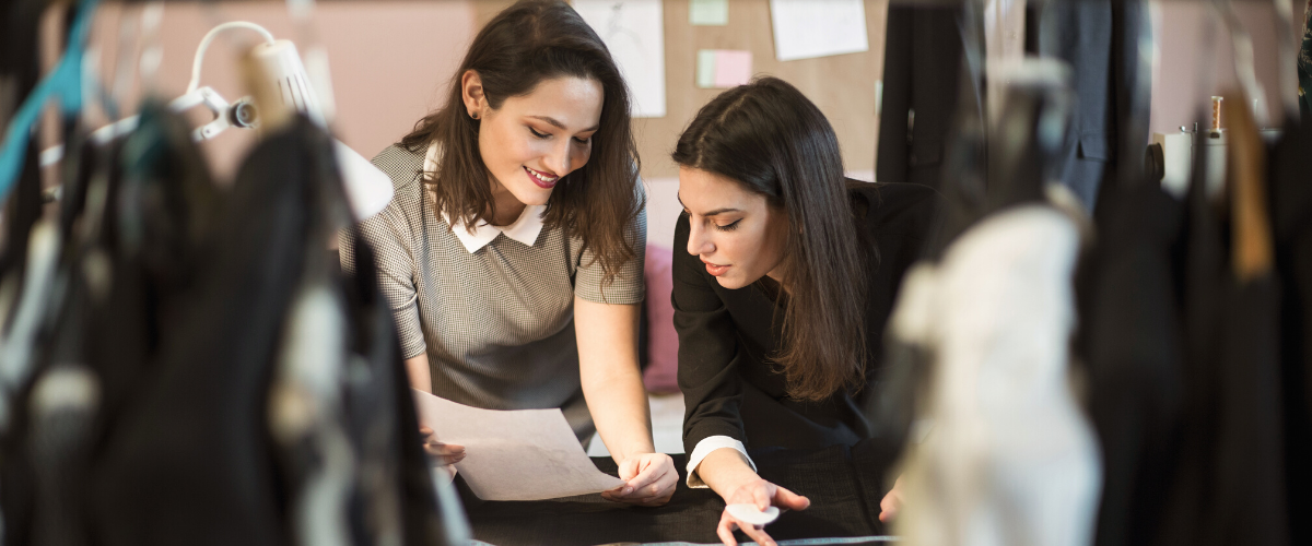 Two-businesswomen-checking-insurance-documents