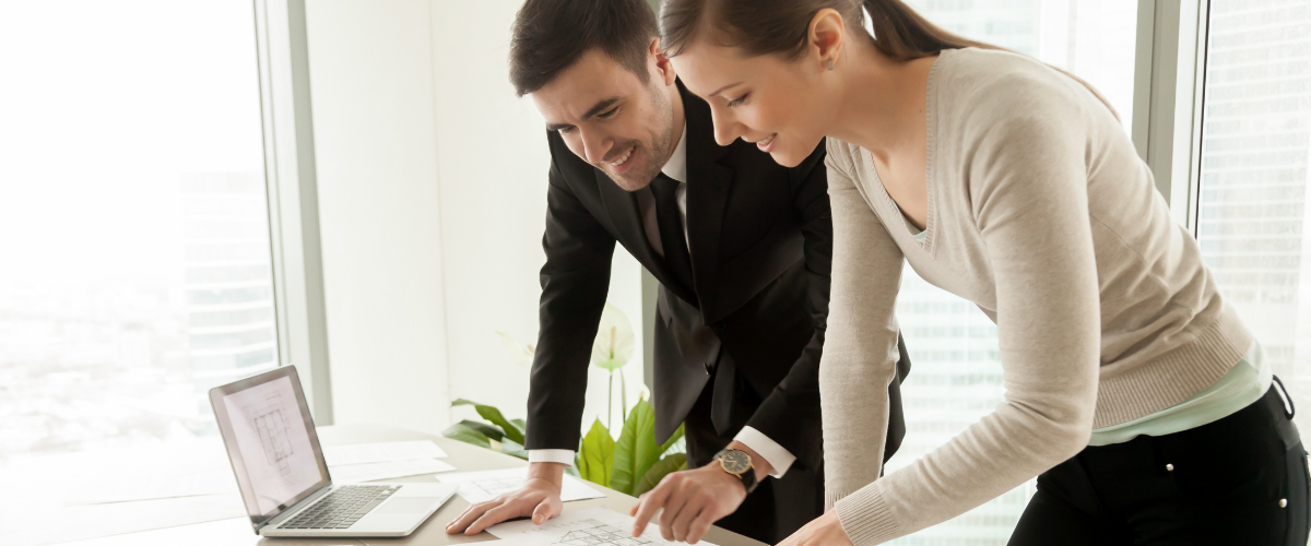 insurance-broker-business-owner-working-together-office