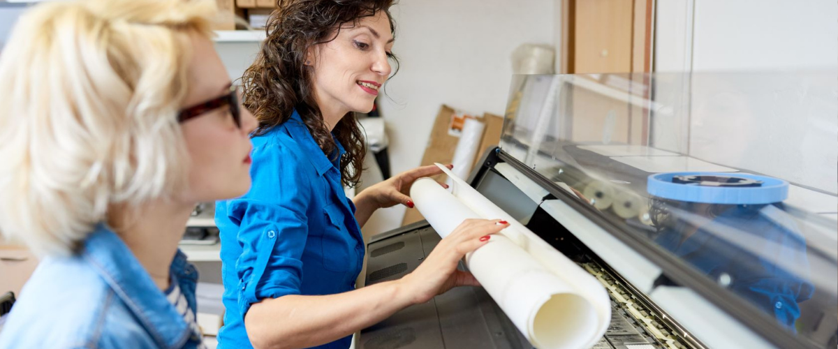 women-operating-printer-business-equipment-assets-protection