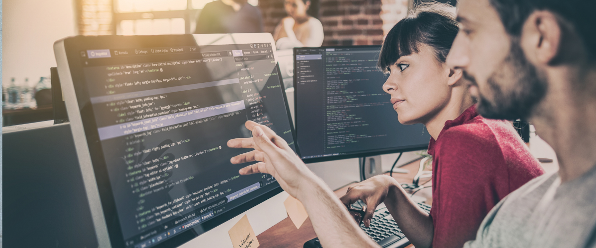 workers-looking-at-code-cyber-attacks-preparedness