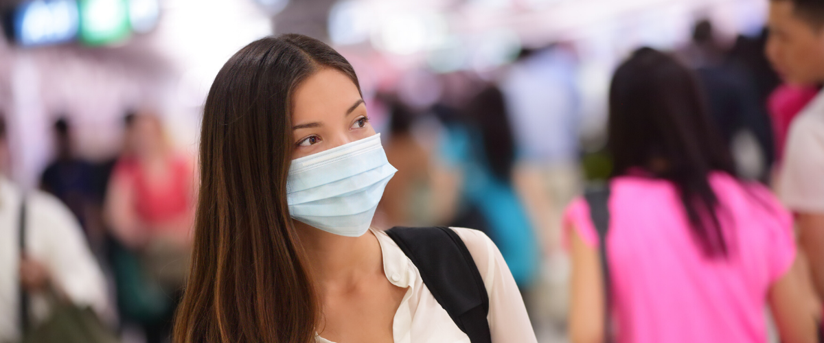 woman-in-face-mask-at-airport